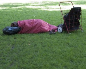homeless asleep in park
